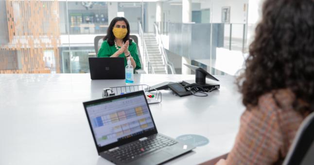 Two people using Microsoft 365
